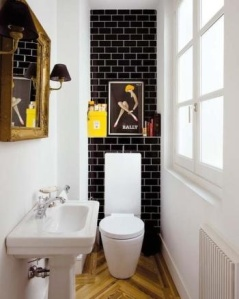 awesome skinny bathroom with black Subway Tile, herringbone floor, amazing windows, yellow accents